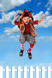 Clhild clown Jumping Fence Royalty Free Stock Photography