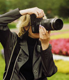 Click. The woman the professional photographer performs the work royalty free stock photography