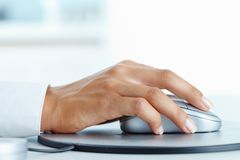 Click. Image of female hand clicking computer mouse stock images