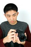 Click!. Close-up young man taking a picture stock photography