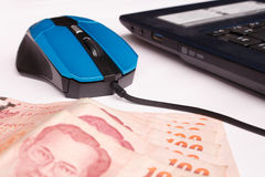 Click computer mouse earn money Stock Images