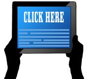 CLICK HERE on tablet screen, held by two hands. Stock Image