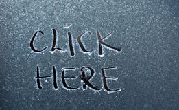 Click here , text. Picture of a Click here , text on frost stock images