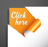 `Click here` text uncovered from torn paper corner. Royalty Free Stock Photo