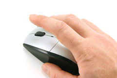 Click the mouse. Hand of a man clicking a mouse button, top view, isolated on white, focus on the finger Royalty Free Stock Photos