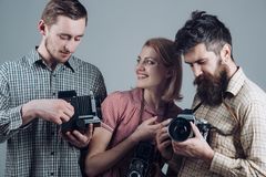 Click with smile. Group of photographers with retro cameras. Paparazzi or photojournalists with vintage old cameras. Retro style women and men hold analog stock photos