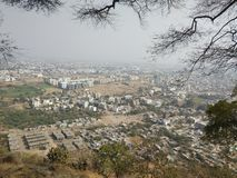 Small town click from hill. A click of town from a hill with shade of trees stock photo
