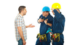 Client arguing with workers. Client man arguing with workers men and asking for explanations against white background stock photography