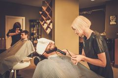 Client in a barber shop Royalty Free Stock Images
