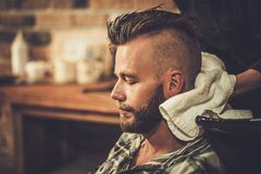 Client in a barber shop Stock Photos