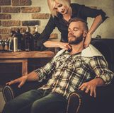 Client in a barber shop Royalty Free Stock Image