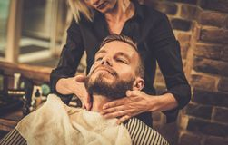 Client in a barber shop Royalty Free Stock Photos