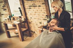 Client in a barber shop. Hipster client visiting  barber shop Royalty Free Stock Photography