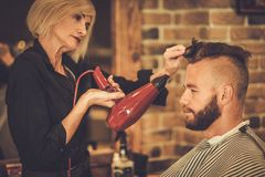 Client in a barber shop Royalty Free Stock Photography