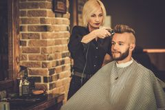 Client in a barber shop Stock Photography