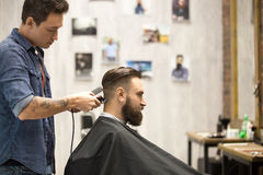 Client in barbershop Stock Images