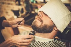 Client during beard and moustache grooming Stock Images