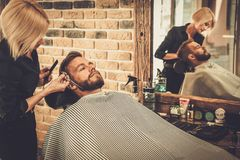 Client during beard and moustache grooming Royalty Free Stock Image