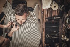 Client during beard and moustache grooming Royalty Free Stock Photography
