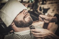 Client during beard and moustache grooming Royalty Free Stock Photo