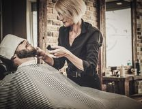 Client during beard and moustache grooming Royalty Free Stock Images