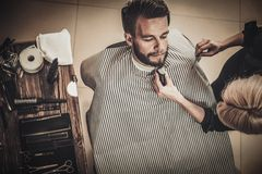 Client during beard and moustache grooming Royalty Free Stock Photos