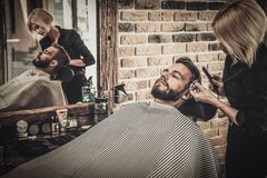 Client during beard and moustache grooming Stock Photo