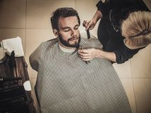 Client during beard and moustache grooming Stock Photography