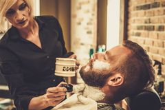 Client during beard shaving Stock Photo