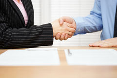 Client and businessman are shaking hands after meeting.  royalty free stock image