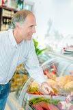 Client buying joint beef. Client buying a joint of beef Royalty Free Stock Photos