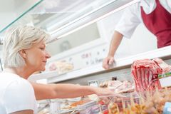 Client buying side meat stock photography