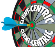 Client-Centric Words Dart Board Targeting Customer Service. Client Centric 3d words on dart board targeting excellent customer service and meeting needs as first stock illustration