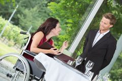 Client conversing with waiter. Client conversing with the waiter Royalty Free Stock Photography