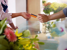 Client with credit card shopping in flowers shop Stock Photography