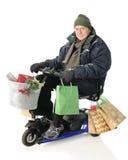 Client de Noël d'équitation de scooter Photos stock
