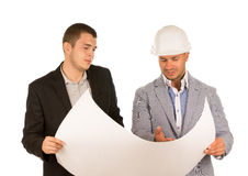 Client and Engineer Looking at Building Blueprint Royalty Free Stock Photography