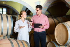 Client and factory staff in wine cellar Stock Photos