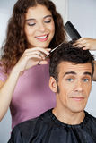Client Getting Haircut From Hairdresser Stock Photo