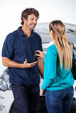 Client Giving Car Keys To Mechanic Royalty Free Stock Photos