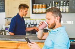 Client got his drink. Have sip of energy. Man client with beard enjoy coffee in paper cup. Drinks to go useful option in. Modern cafe. Man holds paper cup with royalty free stock photography