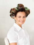 Client With Hair Curlers In Salon Royalty Free Stock Photography