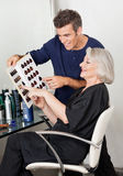 Client And Hairdresser Selecting Hair Color From Royalty Free Stock Photos