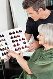 Client And Hairdresser Selecting Hair Color Royalty Free Stock Image