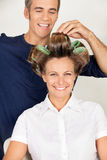 Client With Hairstylist Rolling Her Hair Stock Image