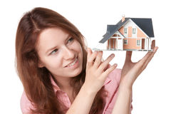 Client with house. Woman (estate agency client) dream about new house - model of the house Stock Photo