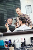 Client looks into the mirror Royalty Free Stock Photos