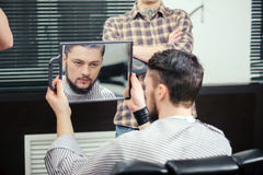 Client looks into the mirror Royalty Free Stock Image