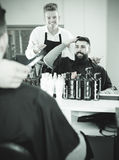 Client making specifications about haircut Stock Images