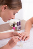 Client and manicurist in manicure salon Royalty Free Stock Images
